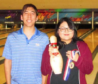 Julia Frias was honored Saturday for her first 800 series. Standing next to her is Winnetka Bowl representative Daniel Giegoldt. Photo by Fred Eisenhammer